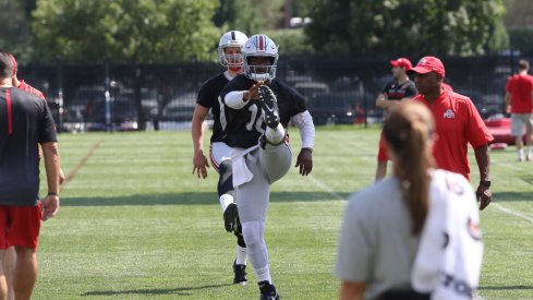 J.T. Barrett goes through warmups on Day 1 of fall camp.