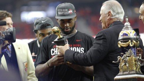 J.T. Barrett accepts his Fiesta Bowl MVP trophy.