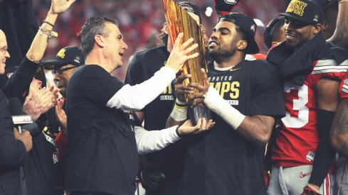 Urban Meyer, Ezekiel Elliott hold up the CFP trophy in 2014.