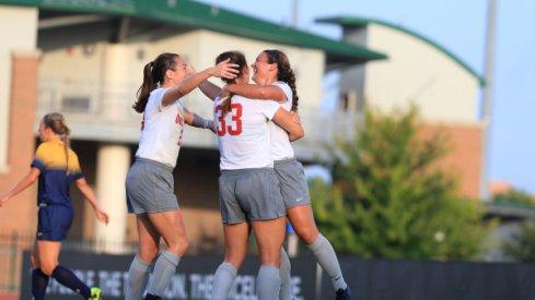 Women's soccer celebrates victory.