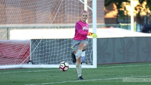 Jillian McVicker kicks a goal kick.