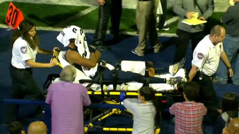 Grimes carted off.
