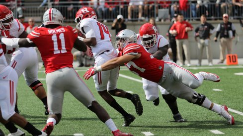 Nick Bosa, Jalyn Holmes get after the Rutgers quarterback.