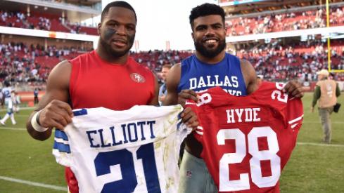 Guapo and Zeke trade jerseys.