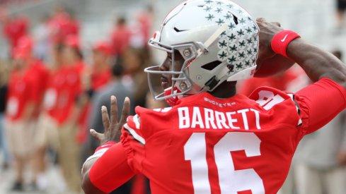 Ohio State quarterback J.T. Barrett warms up Saturday vs. Rutgers.