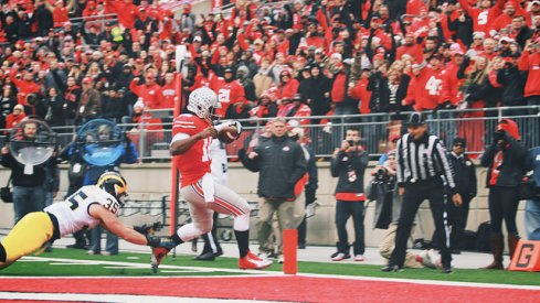 J.T. Barrett beating a Michigan Wolverine to the paint.