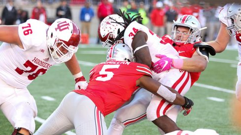 Nick Bosa and Raekwon McMillan combine for a tackle for a loss against Indiana.
