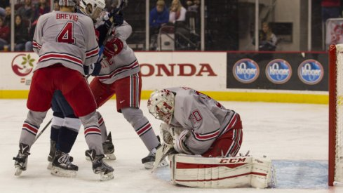 Matt Tomkins tends net during Ohio State hockey's contest against Air Force.