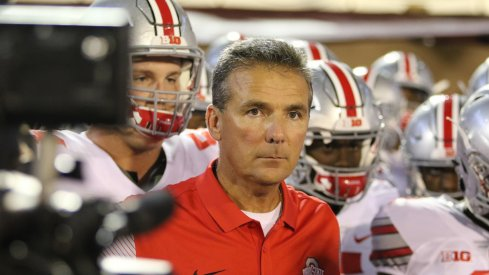 Urban Meyer leads his team on the field against Oklahoma.