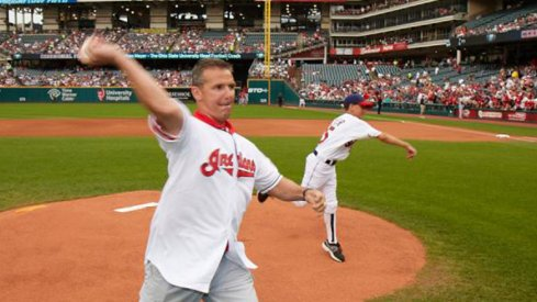 Urban Meyer, seen here throwing out the first pitch at an Indians game, is a huge baseball fan.