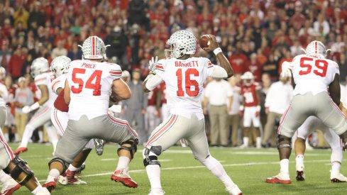 J.T. Barrett drops back to pass vs. Wisconsin.