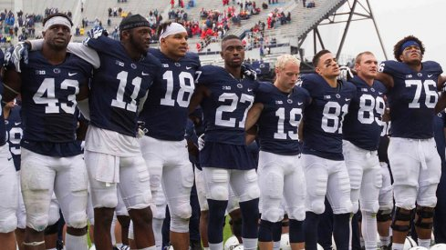 Penn State football players celebrate the team's win over Maryland.