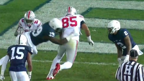 Marcus Baugh scores against Penn State.