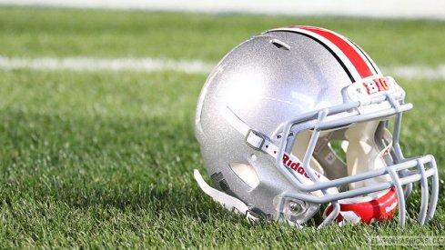 Ohio State helmet on the field at Penn State's Beaver Stadium.