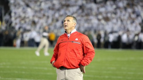 Urban Meyer gazes up at the Beaver Stadium scoreboard.