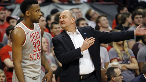 Thad Matta talks to Trevor Thompson during a game last season.