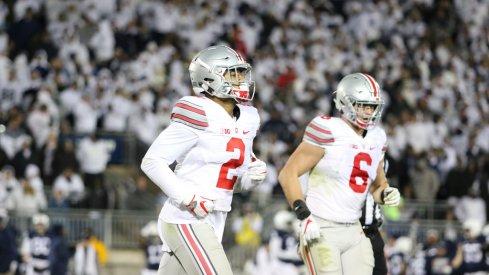 Marshon Lattimore and Sam Hubbard jog off the field following a series at Penn State.