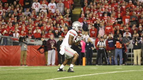 Dontre Wilson fields a punt against Wisconsin.