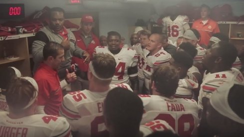 Larry Johnson and Coach Fickell lead the troops after beating Wisconsin.