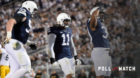Nov 5, 2016; University Park, PA, USA; Penn State Nittany Lions defensive tackle Kevin Givens (30) reacts with teammates linebacker Brandon Bell (11) and defensive tackle Robert Windsor (54) following his sack of Iowa Hawkeyes quarterback C.J. Beathard (not pictured) during the third quarter at Beaver Stadium. Penn State defeated Iowa 41-14. Mandatory Credit: Rich Barnes-USA TODAY Sports