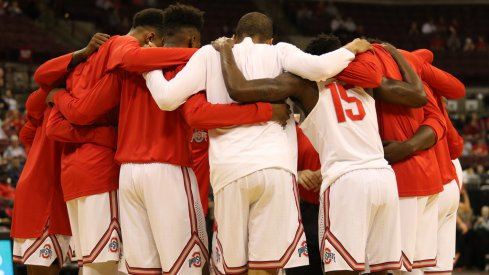Ohio State huddles before its exhibition against Walsh.