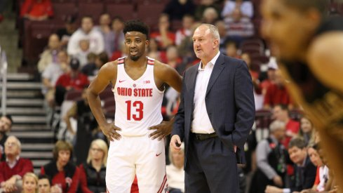 Thad Matta talks with Ohio State point guard JaQuan Lyle.