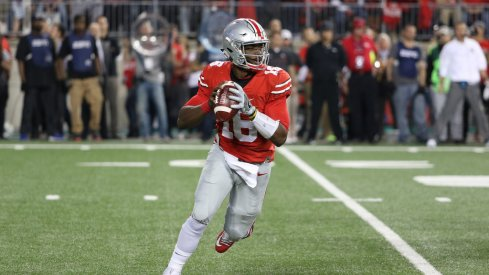 J.T. Barrett rolls out to pass earlier this season.