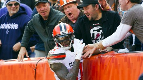 Terrelle Pryor celebrates a touchdown with Cleveland Browns fans.