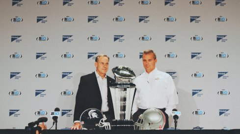 Mark Dantonio and Urban Meyer prior to the 2013 Big Ten championship game.