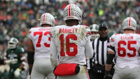 J.T. Barrett gets ready for a snap vs. Michigan State.