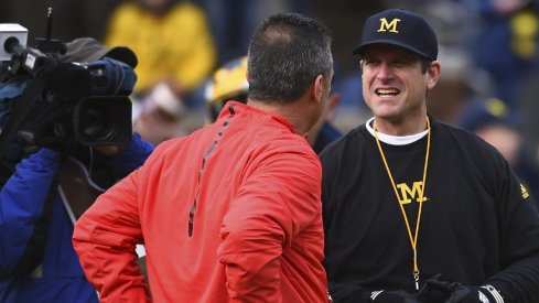 Nov 28, 2015; Ann Arbor, MI, USA; Ohio State Buckeyes head coach Urban Meyer and Michigan Wolverines head coach Jim Harbaugh prior to the game at Michigan Stadium. Mandatory Credit: Tim Fuller-USA TODAY Sports