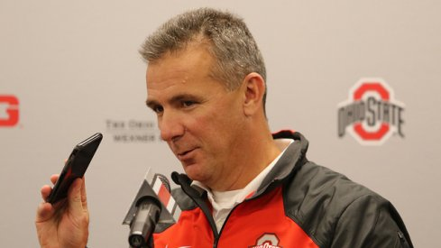 Urban Meyer talks about his wife calling him.