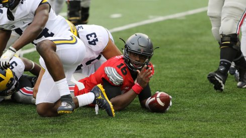 J.T. Barrett dives for a first down against Michigan.