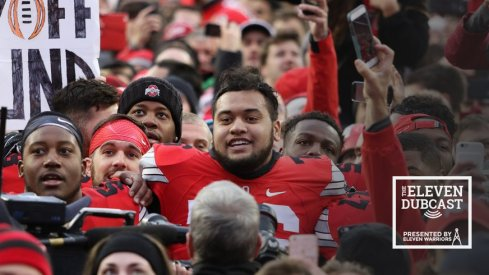 Ohio State players and fans celebrate a dramatic win over Michigan.