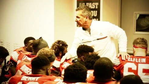 Urban Meyer addresses the team.
