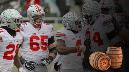 Curtis Samuel is congratulated by The Slobs for a touchdown in East Lansing