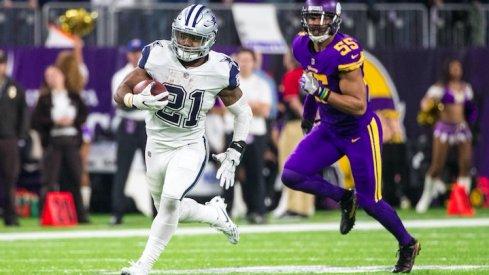 Ezekiel Elliott runs against the Minnesota Vikings.
