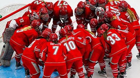 The Ohio State women's hockey Buckeyes huddle up during warm-ups.