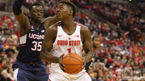 Ohio State's Jae'Sean Tate drives inside against Connecticut.