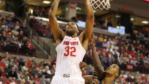 Ohio State center Trevor Thompson scores inside against UConn.