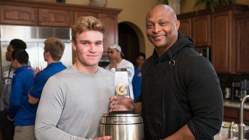 Eddie George surprises Tate Martell with Gatorade Player of the Year Award.