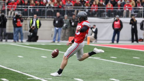 Ohio State's Cameron Johnston makes a punt against Michigan.