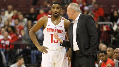 Ohio State coach Thad Matta talks with point guard JaQuan Lyle.
