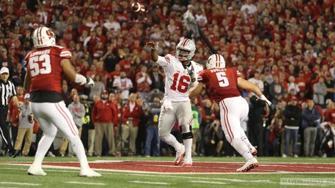 JT Barrett throws a pass against Wisconsin