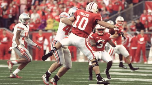 Ohio State linebacker Zach Boren makes a fumble against Wisconsin.