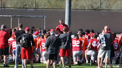 Urban Meyer talks to his team prior to Ohio State's practice Tuesday afternoon.