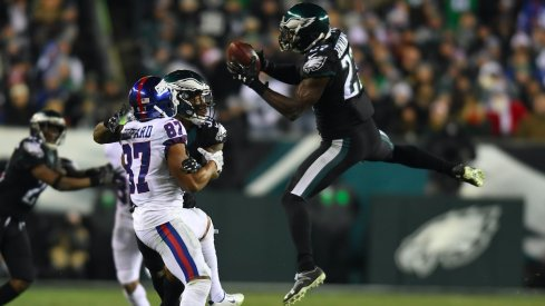Former Ohio State defensive back Malcolm Jenkins intercepts Eli Manning.
