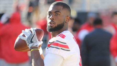 Ohio State quarterback J.T. Barrett warms up for a game earlier this season.