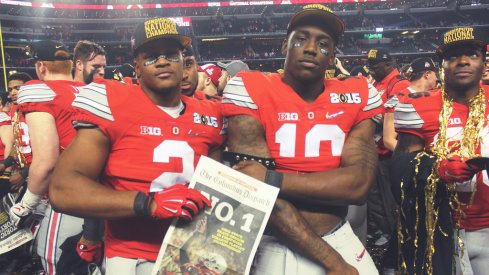 Ohio State's Raekwon McMillan and Jalyn Holmes celebrate the national title in 2014.