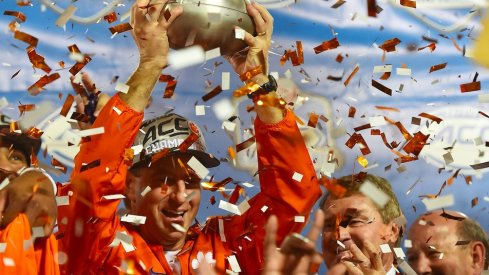 Clemson coach Dabo Swinney celebrates with the 2016 ACC championship trophy.